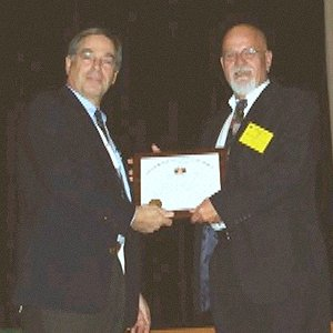 Fred Scheer receives the MBAA Sub Charter from President Larry Sidor.